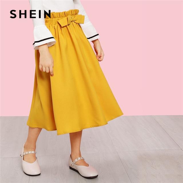 SHEIN Kiddie Ginger/однотонные повседневные юбки с бантом спереди и поясом для девочек Одежда для детей 2019 г. летние милые расклешенные длинные юбки в консервативном стиле