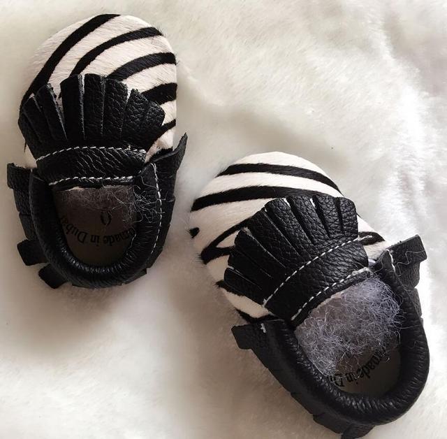 Nuevo estilo de pelo de caballo genuino cuero mocasines bebé Nacido Bebé chicas chicos zapatos Borla suave único primeros caminante zapatos de bebé