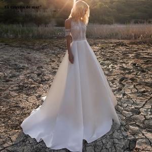 Image 1 - Vestido de noiva2020 nowy O Neck koronki satyna linia ivory plaża boho weselny sukienka ogon suknia slubna gelinlik casamento