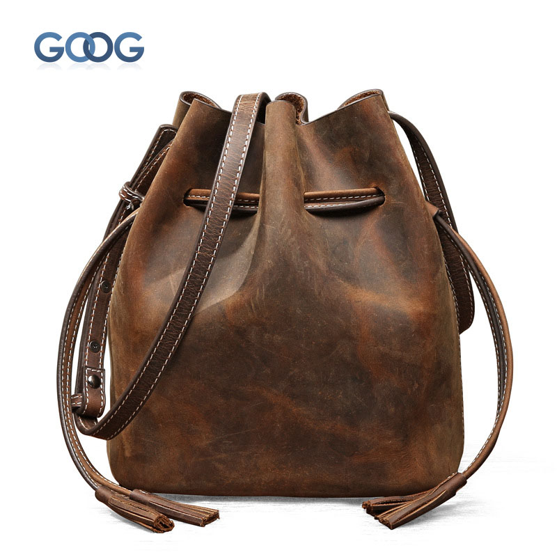 New leather handbags retro bucket bag Korean version of the shoulder bag simple tassel oblique across the package cowhide bag karen cvitkovich leading across new borders
