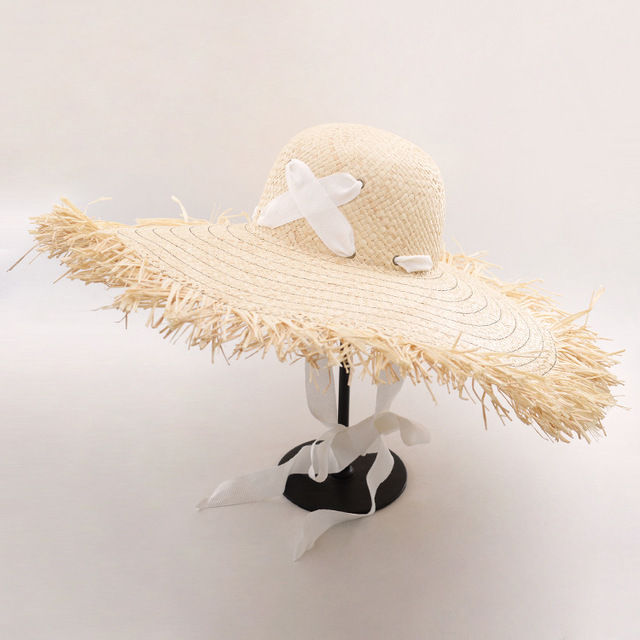 d05cc7156a6 Muchique Wide Brim Sun Hats for Women Raffia Straw Summer Hat Floppy Hat  with Cross Ribbon Tie Beach Hats with Fray Edges