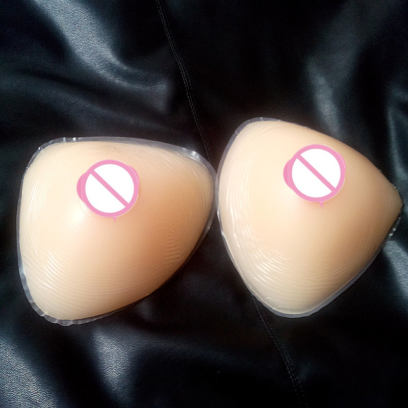 free shipping ,cheap hot selling sexy silicone boobs self-adhesive breast forms triangle shape 600g A/B cup for men