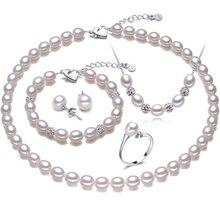 Forma de arroz perla real de cuatro piezas traje accesorios anillo colgante y pendientes de la boda o de la joyería del partido de las mujeres