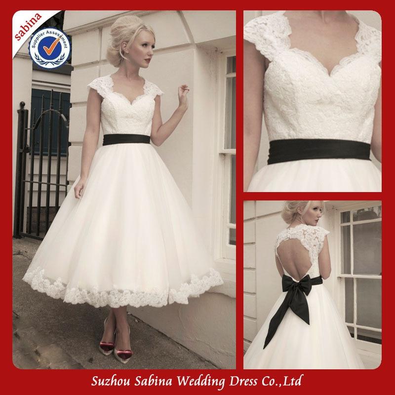 White wedding dress with black bow