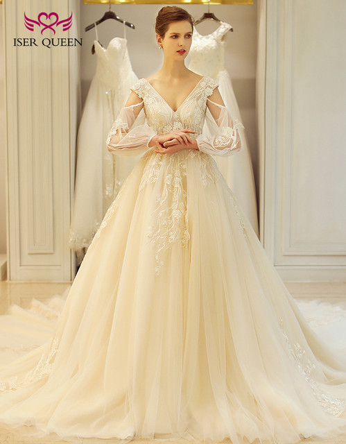 Backless Champagne Color Long Sleeve European American Royal Wedding Dresses  A line Long Train Embroidery Wedding Gown WX0113 d47af9e2c08e