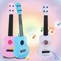 Los niños De Juguete De Plástico Mini Ukulele Pequeña Guitarra Instrumento Regalo 31X9.5X3.5 Cm