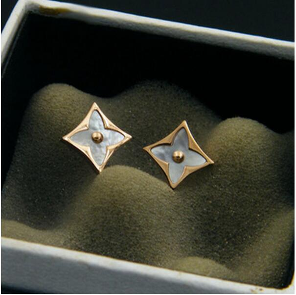 Titanium steel plated with rose gold AAA zircon shaped like a shell and four leaf shaped earrings For women