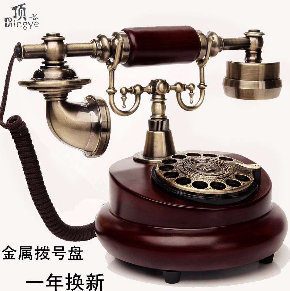 Top, old-fashioned rotary disc telephone antique European garden home phone office landline phone phone household corded phone