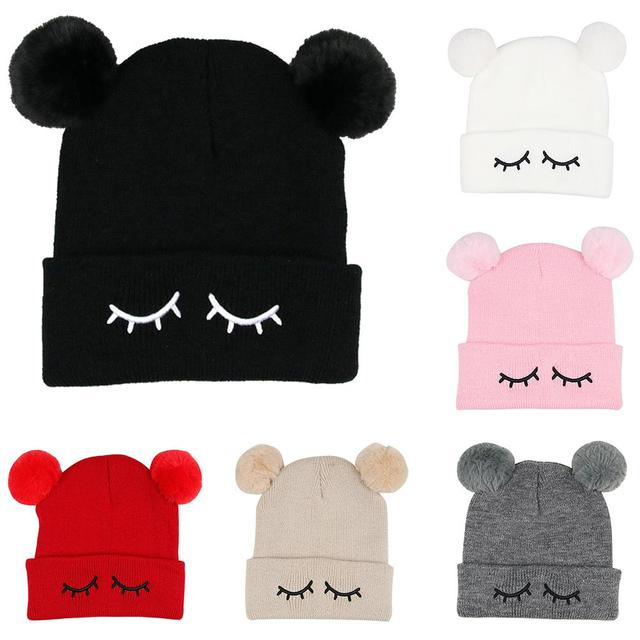 44bb516801b3e Cute Eyelash Shape Embroidery Baby Boys Girls Cap Fur Double Ball Knitted  Warm Winter Wool Hat
