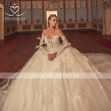 Swanskirt Wedding Dress feathers lace trailing ball gown