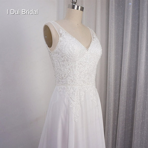 Image 5 - Chiffon A line Wedding Dress V Neckline with Lace Appliques Beaded Illusion Back with Button