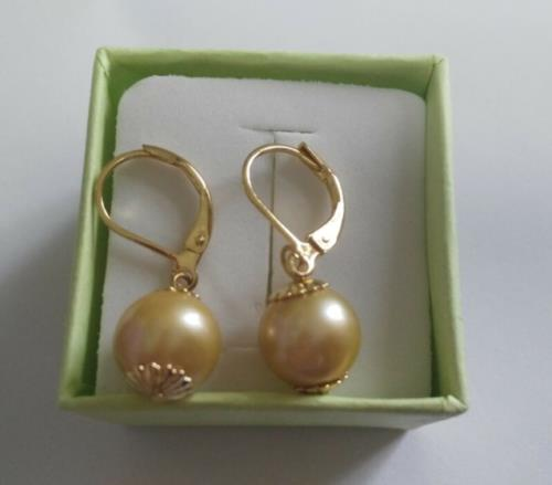 a pair of 10mm natural south sea gold pearl earrings 14K/20 gold hoop pair of gold plated polished big hoop earrings