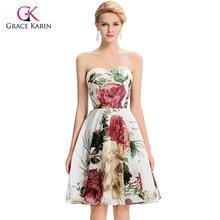 Květinové kratší šaty bez ramínek a širokou sukní