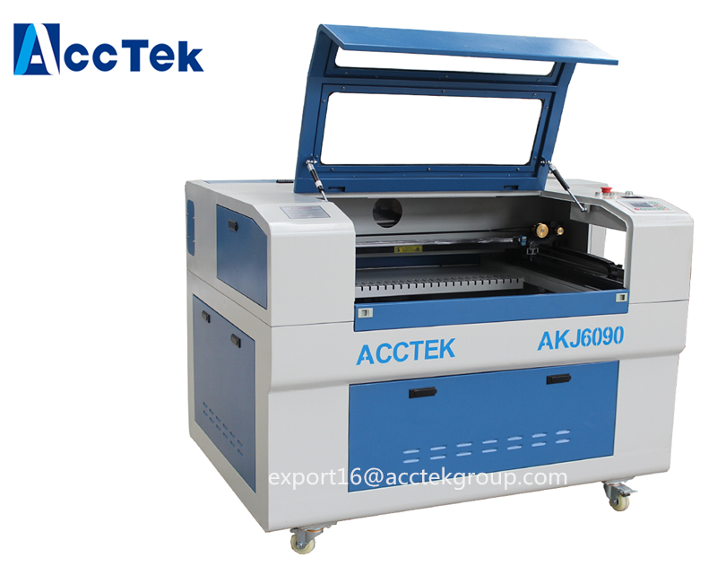 Petite machine de gravure de coupeur de laser de Co2 de tailles de mini travail 6090 6040/offre spéciale CNC la machine de laser ajustent la table de travail de haut en bas