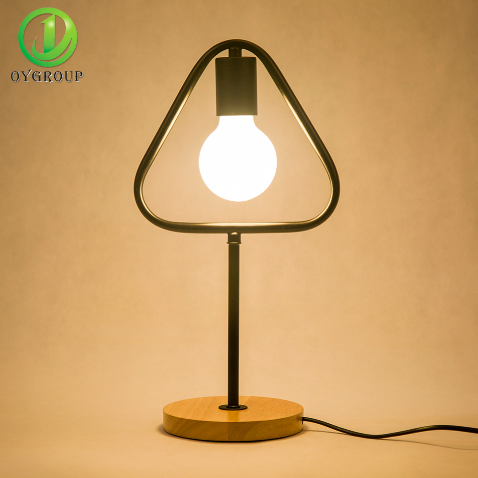 Modern led table light black iron simple e27 solid wood for Modern led table lamps