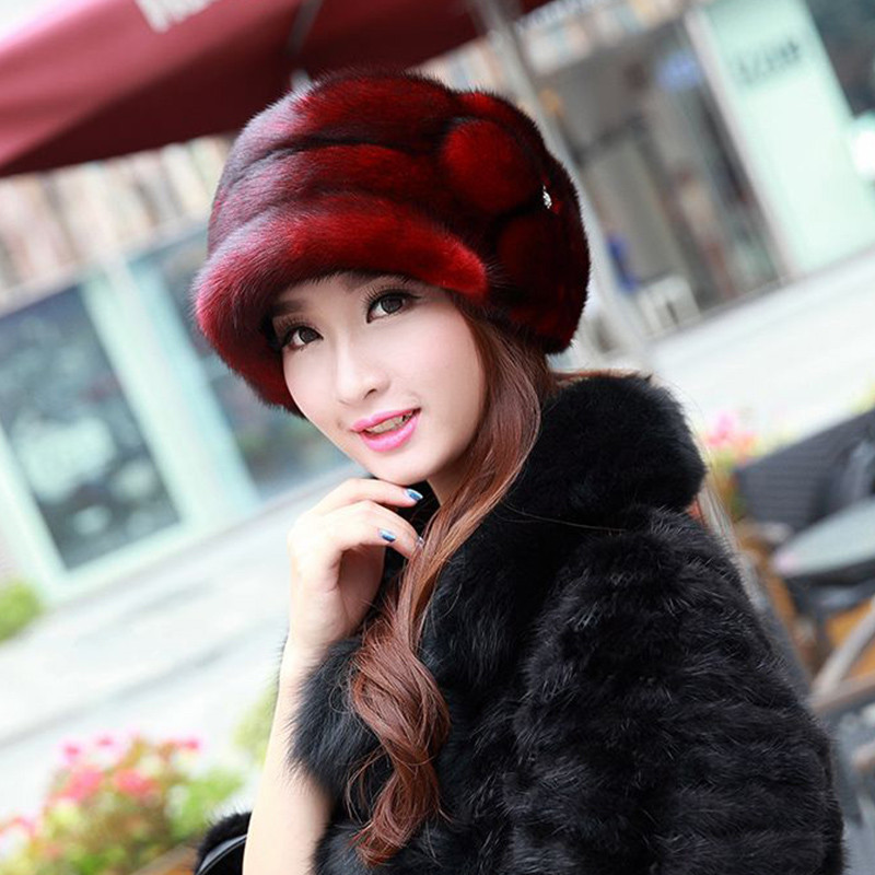 Russian woman selling real mink fur hat with the Royal Mink Pom Pom Beanie handmade genuine
