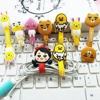 100 unids/lote historieta organizador bobina Winder Protector Cable de gestión titular marcador para auriculares iPhone Sansung