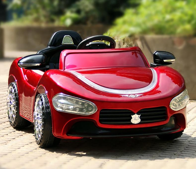 Livraison Gratuite Nouveau Masera enfants peuvent conduire ride sur les enfants télécommande électrique voiture jouet quatre poussette bébé avec bleu phare