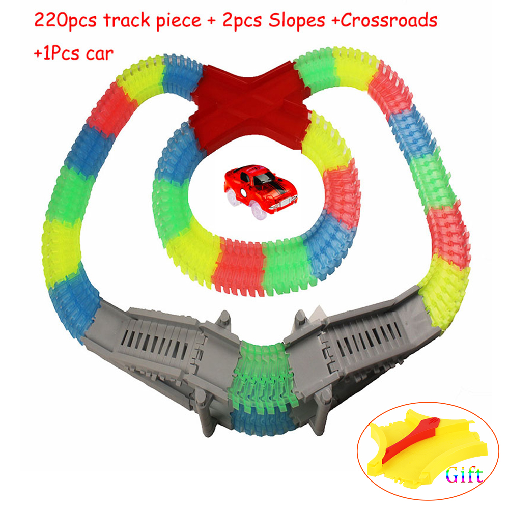 DIY Slot 220pcs Tracks +1 LED Light Car +2 Ramps +1 Intersection Glow Raceway Flexible Curved Luminous Childrens Toys G
