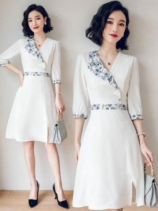 Robe professionnelle 2019 nouveau tempérament à la mode a-ligne robe col en V bijoux boutique vêtements de travail