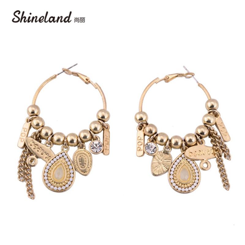 ccc36dcafc07 Shineland moda Bohemia estilo oro color de forma de gota de agua y de larga  cadena colgante étnico declaración pendientes de aro joyas para las mujeres