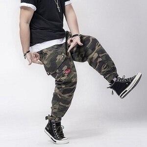 Image 2 - 秋男性カーゴ迷彩パンツポケット高ストリートプラスサイズ 7XL 8XLマンファッションパンツ弾性ウエストパンツアーミーグリーン 50