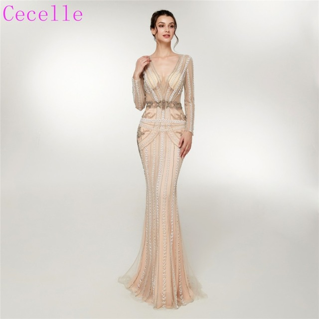 51165bba407 2019 Sexy Champagne Mermaid Long Evening Dresses V Neck Long Sleeves Sheer  Top Luxury Beading Women Couture Evening Gowns