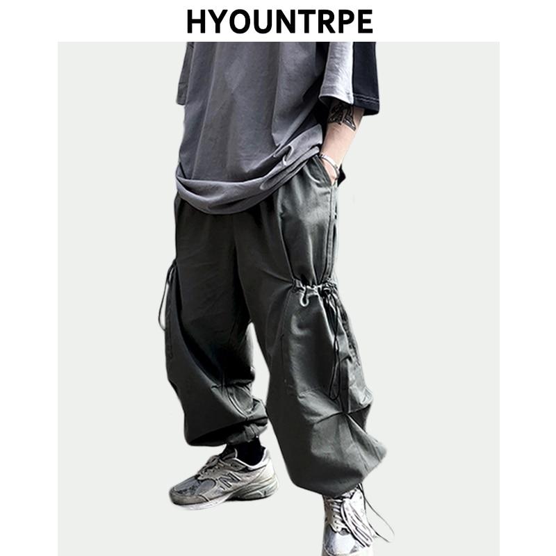 Hip Hop Loose Fit Elastic Waist Pants Fashion Wide Leg Side Big Pocket Cargo Pants Mens New Casual Sportwear Pants Joggers