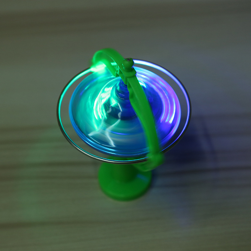 2017 New creative magic glow light up gyro flash UFO gyro puzzle gyro with music box children 39 s toys in Spinning Tops from Toys amp Hobbies