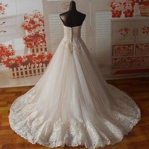 Image 2 - Vestido de novia SF1129, de muestra Real, corte en A, escote Corazón, apliques en el escote, vestidos de boda con dobladillo ancho