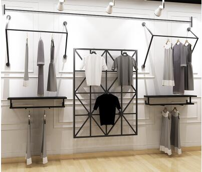 Clothing store display stand floor type men and women clothing shelf display rack side hanging shelf combination . clothing