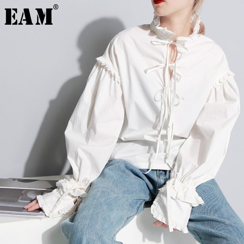 [EAM] 2020 New Spring Stnad Collar Long Sleeve Solid Color Beige Loose Lotus Edge Split Joint Shirt Women Fashion Tide JC87500S