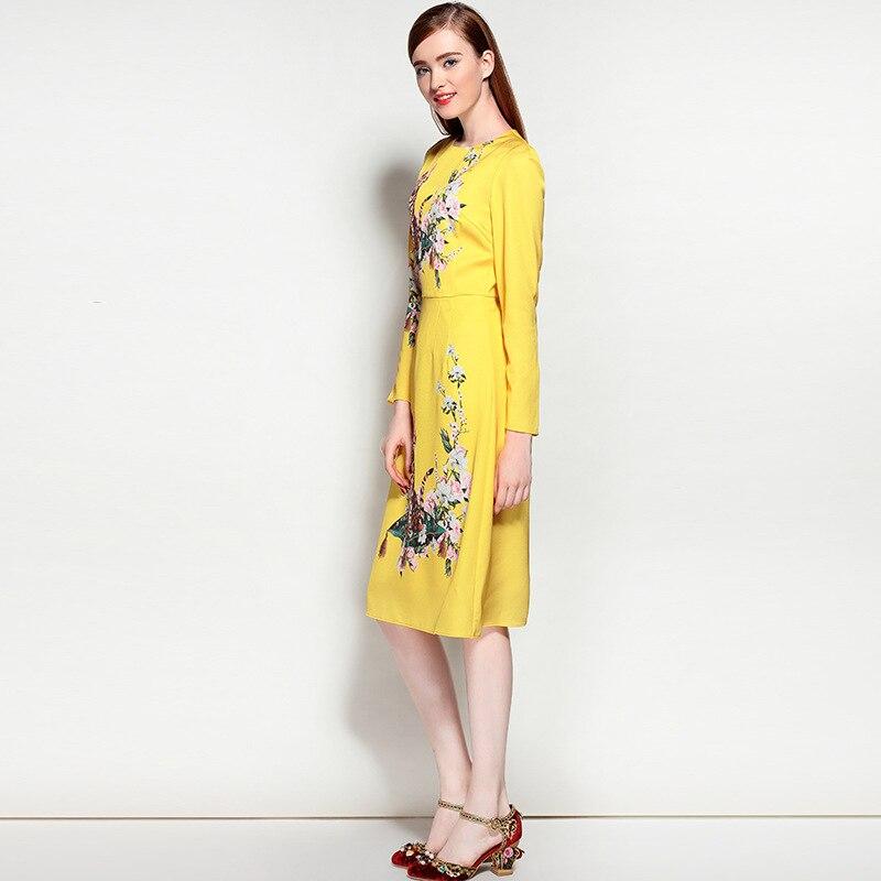 Yellow knee length dress.