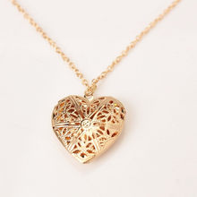 Heart-shaped love necklace can be opened to put a small photo plated Korean hollow female flower peach heart-shaped phase box ne(China)