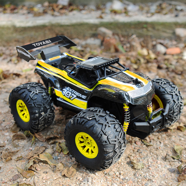 RC coche 2,4G 1/18 15 KM/H de alta velocidad de Control remoto coche monstruo camión de gran tamaño neumáticos Pie Grande RC coche RTR juguetes para niños regalos