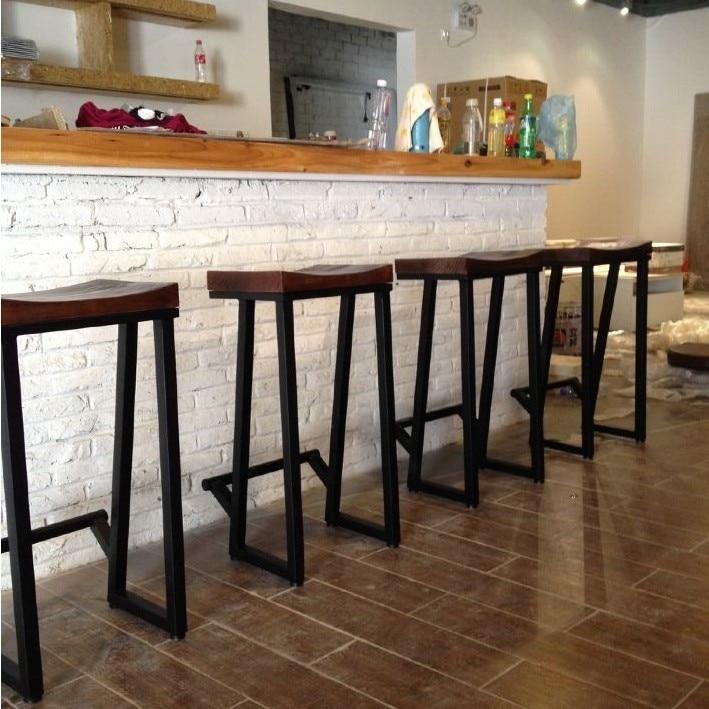 Silla del ocio creativo bar sillas de madera maciza for Sillas para barra americana