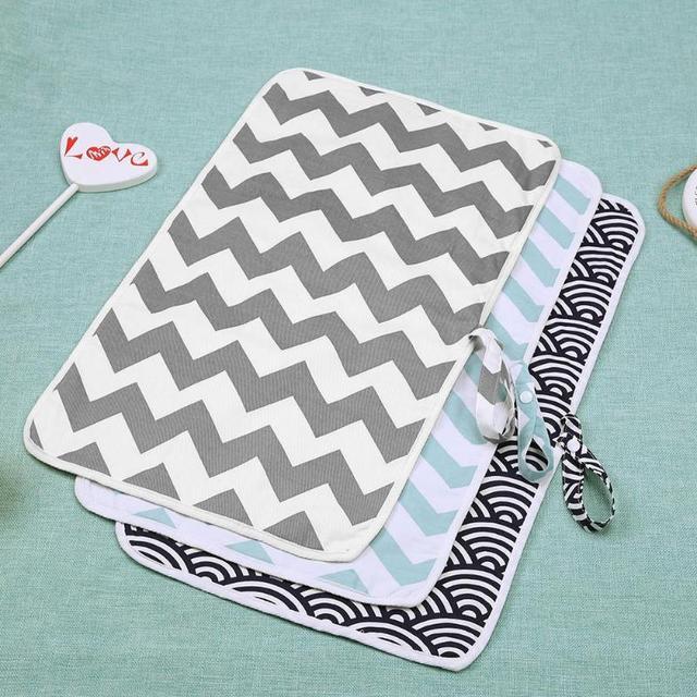 Alfombrilla portátil de algodón para bebé que cambia el pañal plegable impermeable para el cuidado del bebé