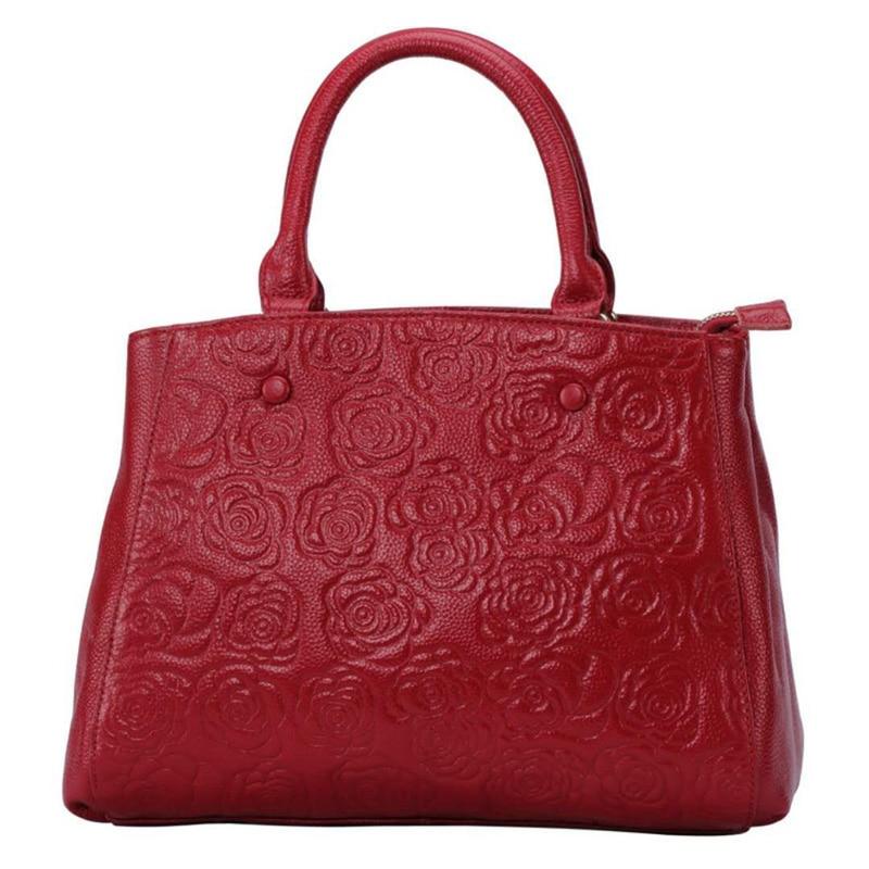 все цены на Fashion Genuine Leather Handbag Female Leather Tote Bag High Quality Floral Embossed Handbag Ladies Shoulder Bag Leisure Tote Sa онлайн