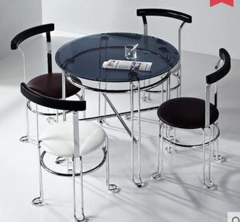 The steel glass small round table. meeting guest discuss the table and chair combination. A of four chairs.