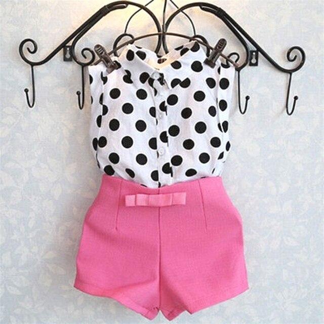 Girl being polka dot black pink — photo 10