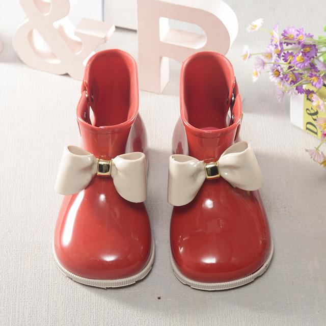Clásica memon girls shoes jalea arco botas de lluvia de pvc de agua shoes flat short nueva shoes kids 3 colores kids shoes
