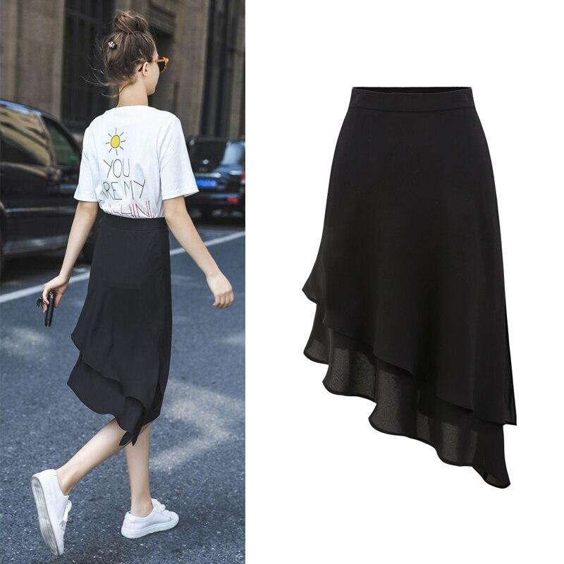 Été nouveau mode Loisirs irrégulière taille Haute Dans la longue section  noir jupe Plissée Angleterre style b91c76bc174