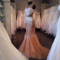 Luxury Crystals Beaded Mermaid Prom Dresses Sheer Tulle Long Heavy Rhinestones Champagne Evening Party Gowns Abendkleider 2018