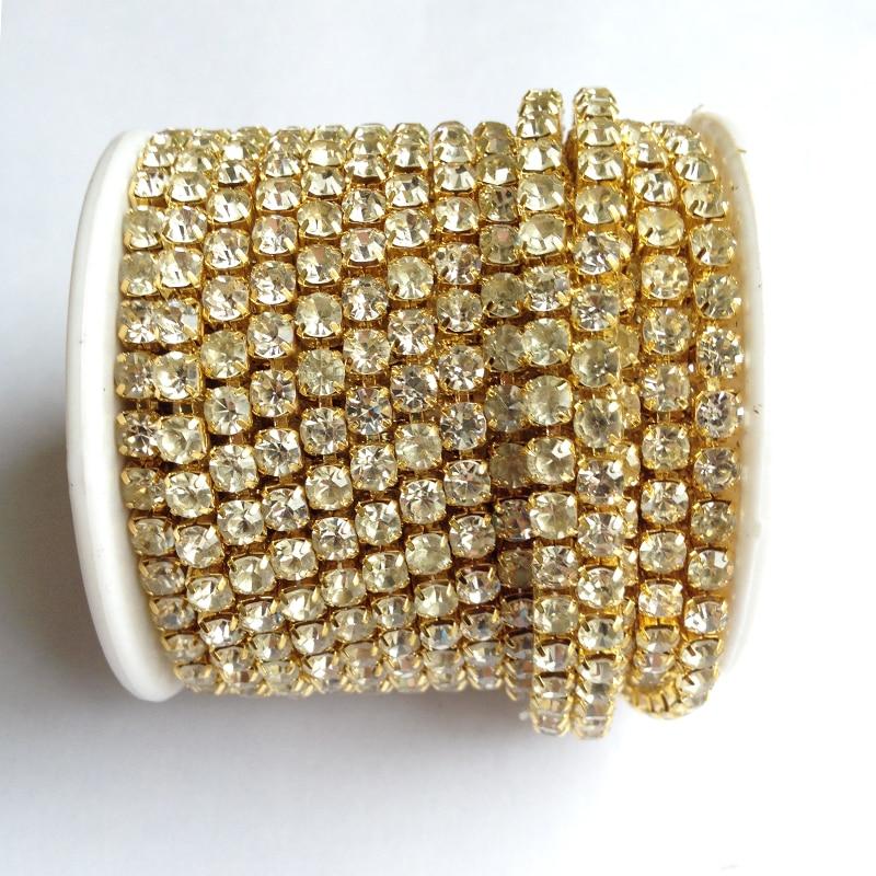 arany alap tiszta kristály strasszos SS6 SS18 intenzív 10 yard / roll új stílus diy szépség kiegészítők strasszos lánc