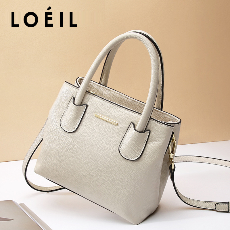 LOEIL 2018 new leather female bag women's shoulder slung handbag bag female European and American fashion small square bag loeil autumn and winter leather cylinder bag female 2018 new cowhide round shoulder slung small bag portable