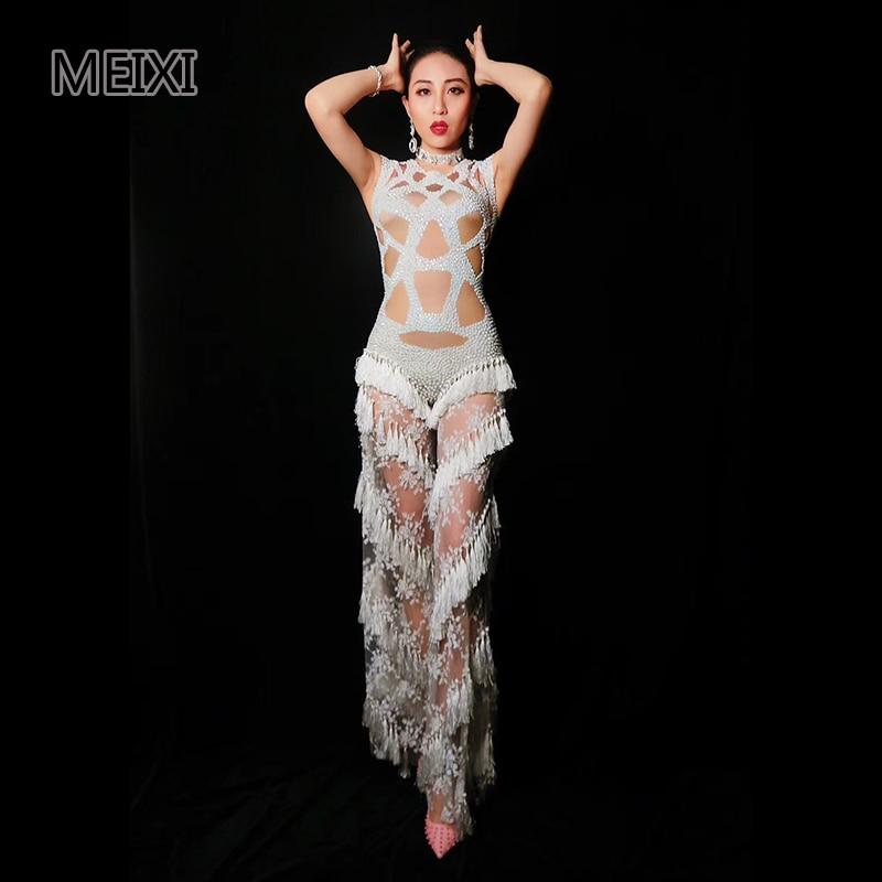 The sexy net drills in the white fringe rhinestone bar nightclub concert singer's performance dress