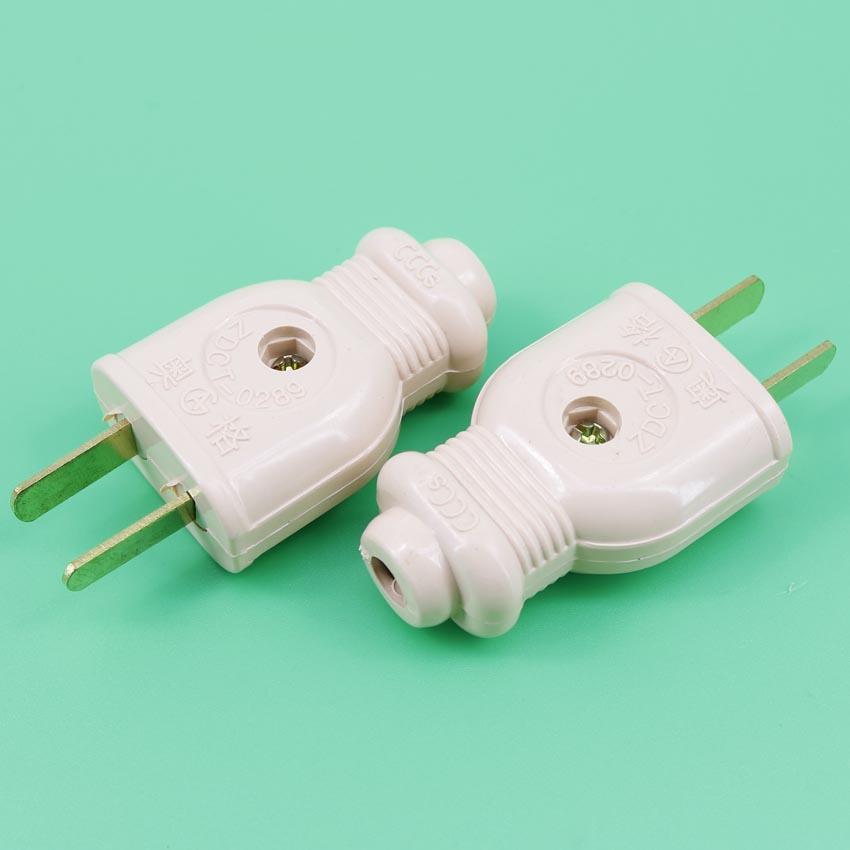 extension cords on two flat pin connectors supporting male and female head on the plug socket