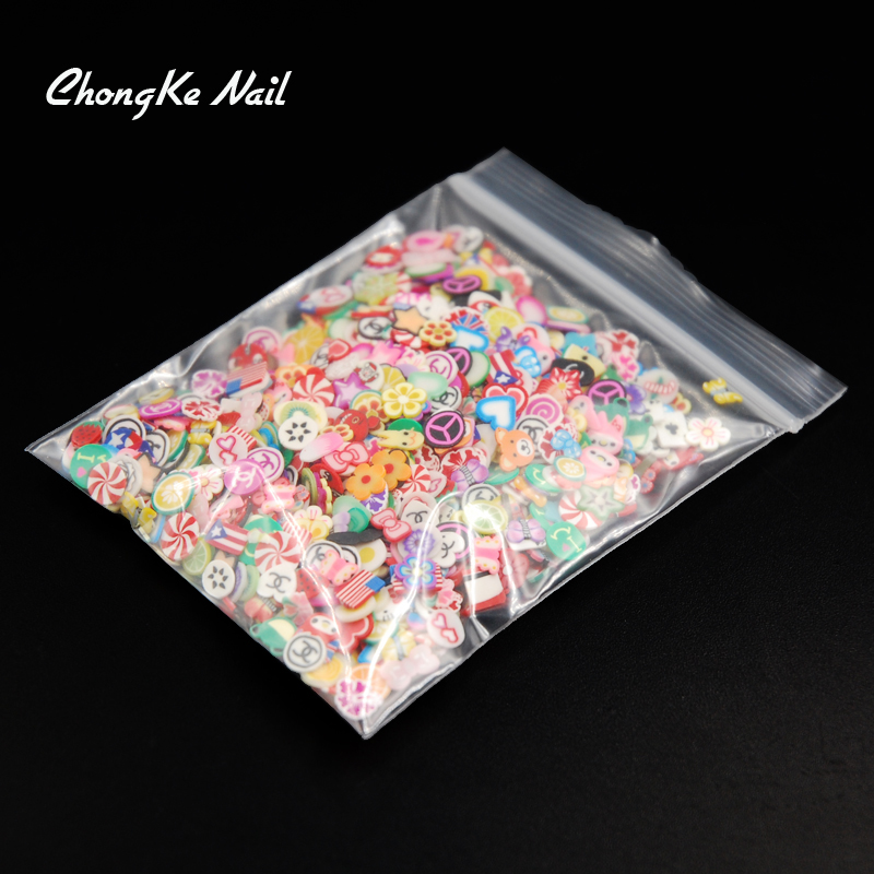 2000pcs pack Nail Art 3D Fruit Feather Heart Flower Candy Mixed Designs Tiny Fimo Slices Polymer Clay Nail Sticker Decoration in Rhinestones Decorations from Beauty Health
