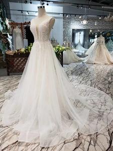 Image 4 - LSS508 ボヘミアンウェディングドレス v ネックノースリーブ a ライン格安ウェディングドレスシンプルなビーチブライダルドレス vestidos デ noiva 2020