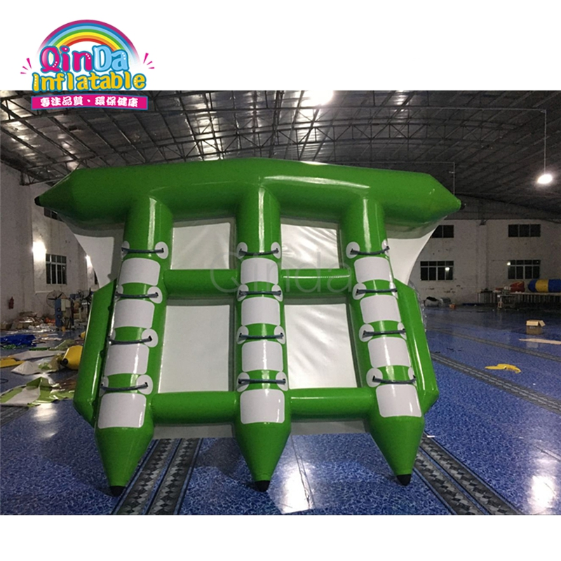 Commercial grade 100% PVC tarpaulin 6 person Inflatable flying fish towable for rental commercial sea inflatable blue water slide with pool and arch for kids